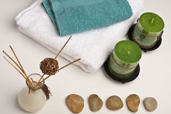 Spa candles, fragrance and towels Royalty Free Stock Photo
