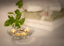 Spa candles in glass with  water Stock Photos