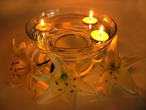 Spa candles lily petals Royalty Free Stock Images