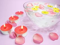 Spa candles pink rose petals Royalty Free Stock Images