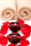 Spa candles with rose petals Royalty Free Stock Image