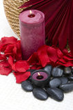 Spa candles, stones and petals Royalty Free Stock Photo