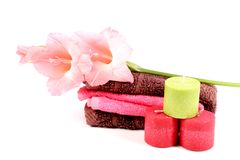 Spa candles and towels. Beautiful shot of pink colored wax spa candles with towels Royalty Free Stock Image