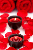 Spa candles, towels, rose petals Stock Image