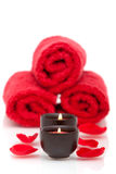 Spa candles, towels, rose petals Stock Photo