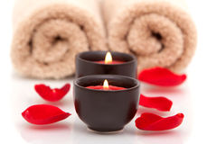 Spa candles, towels, rose petals Royalty Free Stock Photography