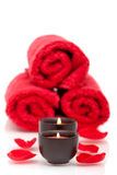 Spa candles, towels, rose petals Royalty Free Stock Photos