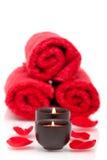 Spa candles, towels, rose petals Royalty Free Stock Photos
