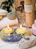 Spa candles in water Royalty Free Stock Photography