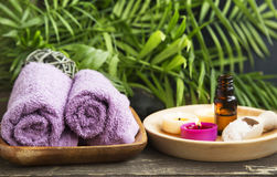 Spa Care with Cotton Towels, Essence and Scent Candles Royalty Free Stock Images