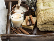 Spa-care products with coffee and cinnamon soap, towel and candl Royalty Free Stock Photography