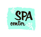 Spa center. Ink hand drawn lettering with a green leaf. Modern brush vector calligraphy. White background. Elegant hand lettering for your design Stock Photo