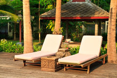 Spa chairs on pool deck stock photo