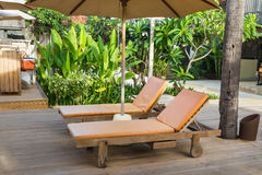 Spa chairs on pool deck stock photography