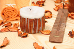 SPA cinnamon candle with dried-up orange petals Stock Images