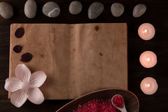 Spa composition with aroma candles and empty vintage open book on wooden background. Treatment, aromatherapy Royalty Free Stock Images