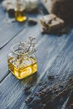 Spa composition. Aroma essential oil on rustic wooden background, selective focus.  Stock Photo