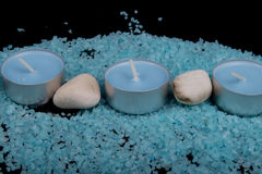 Spa composition in blue, candles and blue sea salt with stones Stock Photography