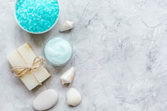 Spa composition with blue salt and soap on stone background top view mockup. Homemade spa composition with blue sea salt and natural soap on stone desk Stock Images