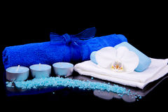Spa composition in blue with scented candles, white orchid flowe Stock Image