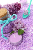 Spa composition of candle, bottle and lilac Royalty Free Stock Photos