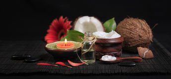 Spa composition. With candle, flowers and coconut oil Stock Photos