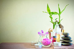 Spa composition with candle, pebbles and aroma oil. Royalty Free Stock Image