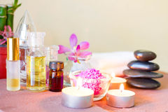 Spa composition with candle, pebbles and aroma oil. Stock Photos