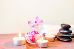 Spa composition with candle, pebbles and aroma oil. Stock Images