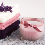 Spa setting with bath towels and salt Stock Photos