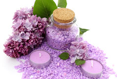 Spa composition of candles, bottle and flowers lilac Stock Photography