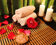 Spa composition with candles. Spa still-life with candles, sea salts, towel and rose petals Stock Photography