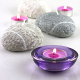 Spa composition with colorful candles Royalty Free Stock Images