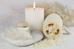 SPA composition with cream, candle and loofah Stock Photography
