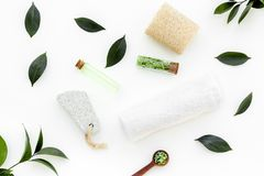 Spa composition with essential tea tree oil. Fresh tea tree leaves, natural cosmetics, towel on white background top royalty free stock image
