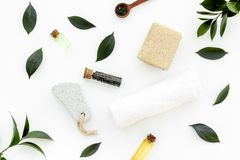 Spa composition with essential tea tree oil. Fresh tea tree leaves, natural cosmetics, towel on white background top. View royalty free stock image