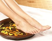 A spa composition of female feet and a bowl Royalty Free Stock Photography