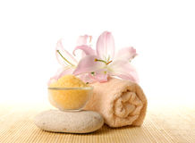A spa composition of flowers, salt and a towel Royalty Free Stock Image
