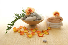 A spa composition of flowers, stones and bamboo Stock Photos
