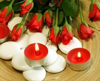 Spa Composition Of Candles, Stones And Roses Royalty Free Stock Images