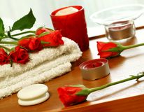 Spa Composition Of Towel, Candles And Red Roses Stock Photography