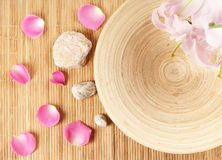 A spa composition of petals, stones and bamboo Stock Photo