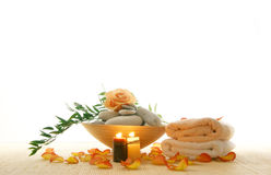 A spa composition of petals, stones and towels Royalty Free Stock Photography