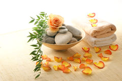 A spa composition of petals, stones and towels Royalty Free Stock Image