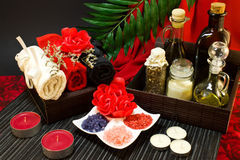 Spa composition in red and black colors with towels Stock Photo