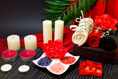 Spa composition in red and black colors with towels Stock Image