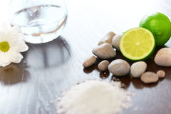 Spa composition. Salt Lime Flower and Stones. Body scrub. Royalty Free Stock Photography