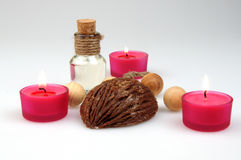 Spa composition. scented candles, coffee beans, aromatic wooden balls Stock Photos
