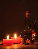 Spa composition. scented candles, coffee beans, aromatic wooden balls Royalty Free Stock Photography