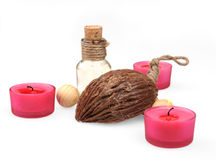 Spa composition. scented candles, coffee beans, aromatic wooden balls and oil in a glass jug with a stopper. Royalty Free Stock Photos
